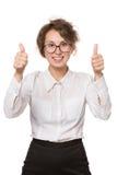 Mädchen in einer weißen Bluse steht auf einem weißen Hintergrund, Gesten, Gefühle auf ihrem Gesicht Lizenzfreies Stockbild