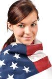 Mädchen eingewickelt in der amerikanischen Flagge Stockbilder