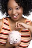 Mädchen-Einsparung-Geld Lizenzfreie Stockbilder
