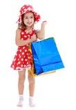 Mädchen geht, das Einkaufen zu tun Stockfotos