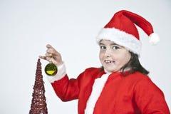 Mädchen gekleidet als Weihnachtsmann mit Weihnachten Stockbilder