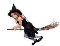 Mädchen in Hexenhalloween-Kostüm stockbilder