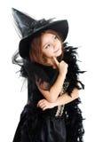 Mädchen in Hexenhalloween-Kostüm lizenzfreie stockfotografie