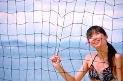 Mädchen hinter Netz Stockfotos