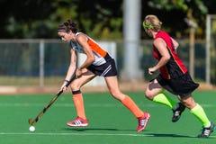 Mädchen-Hockey-Spiel-Tätigkeit Astro Lizenzfreies Stockfoto