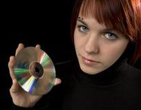 Mädchen holdind eine Digitalschallplatte Stockfotos