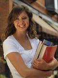 Mädchen-Holding-Bücher Lizenzfreie Stockfotos