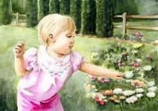 Mädchen im Blumen-Garten Stockbilder