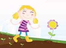 Mädchen im Garten stock abbildung