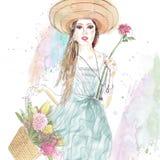 Mädchen im Hut mit Tasche und Blumen Stockbild