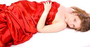 Mädchen im langen roten Kleid Lizenzfreie Stockfotos