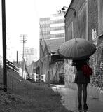 Mädchen im Regen Stockfotografie