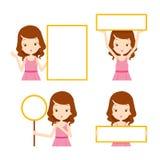 Mädchen im rosa Kleid, welches die leeren Zeichen eingestellt zeigt Stockfotos