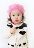 Mädchen im rosafarbenen Hut mit Lollipop2 Stockbilder