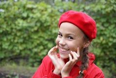 Mädchen im Rot Stockfotos