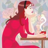 Mädchen im Rot im Kaffee Stockbilder