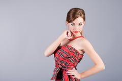 Mädchen im roten Kleid stockbild