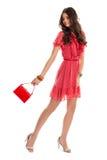 Mädchen im roten Kleiderlächeln Stockbilder