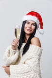 Mädchen im Weihnachten mit Champagner Lizenzfreie Stockfotos