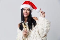 Mädchen im Weihnachten mit Champagner Lizenzfreie Stockfotografie