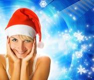 Mädchen im Weihnachtshut Stockfotos