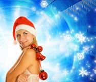 Mädchen im Weihnachtshut Stockbilder