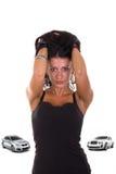 Mädchen liebt teure Autos Stockfotografie