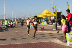 Mädchen-Marathonlauf-Aktion Stockfotografie