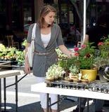 Mädchen am Markt Stockbild