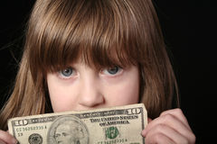 Mädchen mit 10 Dollarschein Stockfotografie