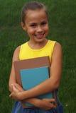 Mädchen mit Büchern Lizenzfreie Stockbilder