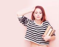 Mädchen mit Büchern Lizenzfreie Stockfotos