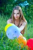 Mädchen mit Ballonen Stockfoto