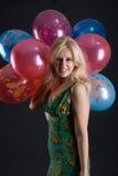 Mädchen mit Ballons Stockbild