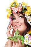 Mädchen mit Basisrecheneinheit und Blume auf Kopf. Stockfotos