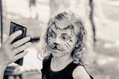 Mädchen mit dem Facepainting Stockfotografie