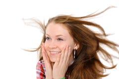 Mädchen mit dem Haar, das im Wind flattert Stockbild