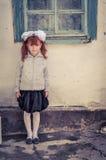Mädchen mit dem roten Haar in Kirgisistan Stockfotografie