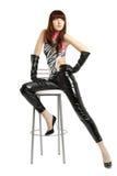 Mädchen mit den sehr langen Fahrwerkbeinen in den ledernen Hosen Stockbild