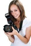 Mädchen mit der Berufsdigitalkamera lokalisiert auf weißem Hintergrund Stockbild