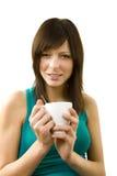 Mädchen mit der Kaffeetasse (getrennt auf Weiß) Stockbilder