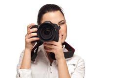 Mädchen mit der Kamera auf einem Weiß Lizenzfreie Stockfotografie