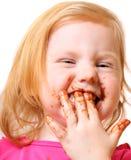 Mädchen mit der Schokolade getrennt worden auf Weiß Stockfotografie