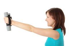 Mädchen mit Dumbbells Lizenzfreies Stockfoto