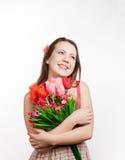 Mädchen mit einem Blumenstrauß Stockbild
