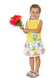 Mädchen mit einem Blumenstrauß der Blumen Lizenzfreies Stockfoto