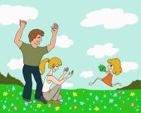 Mädchen mit einem Frosch und glücklichen Eltern Stockfotos