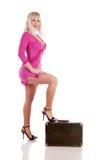 Mädchen mit einem Koffer Stockfotografie