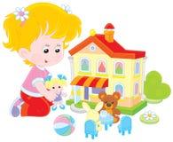 Mädchen mit einem Puppen- und Spielzeughaus stock abbildung