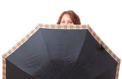 Mädchen mit einem Regenschirm. Lizenzfreies Stockfoto